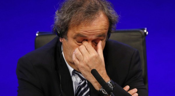 FILE - In this May 24, 2013 file photo UEFA President Michel Platini reacts as he speaks to members of the media at the end of the 37th Ordinary UEFA Congress in London. On Thursday, Oct. 8, 2015 photo FIFA provisionally banned Platini for 90 days. (AP Photo/Sang Tan)