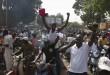 Scène de liesse populaire dans les rues de Ouagadougou, le 31 octobre 2014 après le départ du pouvoir de Blaise Compaoré. © REUTERS/Joe Penney