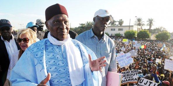 Abdoulaye Wade, 91 ans, reprend du service (ici lors d'un meeting, le 21 novembre 2014). © SEYLLOU/AFP