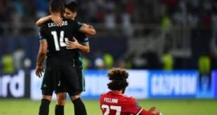 Les joueurs du Real Madrid Casemiro et Marco Asensio célèbrent leur victoire contre Manchester United.