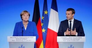Le président français Emmanuel Macron et la Chancelière allemande Angela Merkel, à Paris, le 13 juillet 2017.