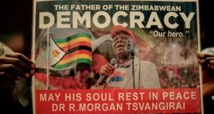 Getty Images Image caption Un militant tient une affiche à l'honneur de l'opposant Morgan Tsvangirai.