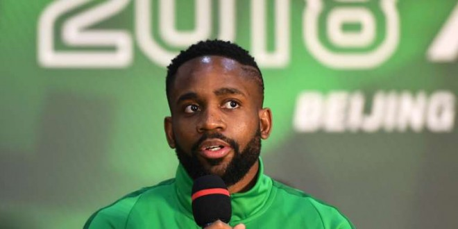 Congolese football player Cedric Bakambu speaks at a press conference by his new team Beijing Guoan in Beijing on March 1, 2018.  Chinese Super League club Beijing Guoan officially presented their new striker Congolese international Cedric Bakambu on March 1, completing a drawn-out transfer saga from his former Spanish team Villarreal. / AFP / Greg Baker