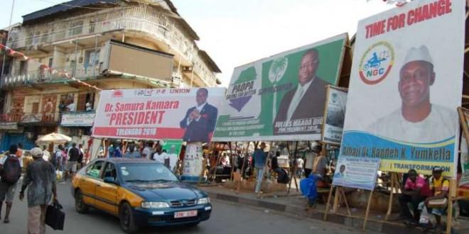 © Saidu Bah, AFP Les affiches de campagne des candidats dans les rues de la capitale Monrovia.
