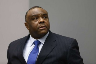 (FILES) In this file photo taken on June 21, 2016 Former Crédits : MICHAEL KOOREN / AFPCongolese vice-president Jean-Pierre Bemba sits in the courtroom of the International Criminal Court (ICC) in The Hague.  International Criminal Court (ICC) in The Hague aquitted Former Congolese vice-president Jean-Pierre Bemba on appeal on June 8, 2018.  / AFP PHOTO / POOL / Michael Kooren
