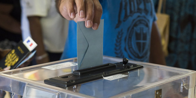 A resident of New Caledonia's capital, Noumea, casts his vote at a polling station as part of an independence referendum, Sunday, Nov. 4, 2018. Voters in New Caledonia are deciding whether the French territory in the South Pacific should break free from the European country that claimed it in the mid-19th century. (AP Photo/Mathurin Derel)